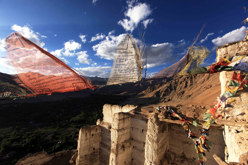 Prayer flags dancing in the wind above the ruined ramparts of Sankar Gompa, Ladakh, northwest India, 167 kb