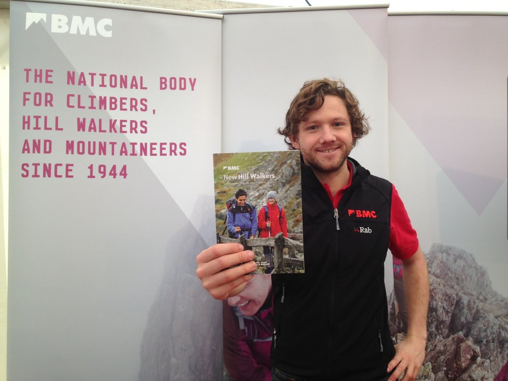 Carey on the BMC's stall at the Kendal Mountain Festival, 87 kb