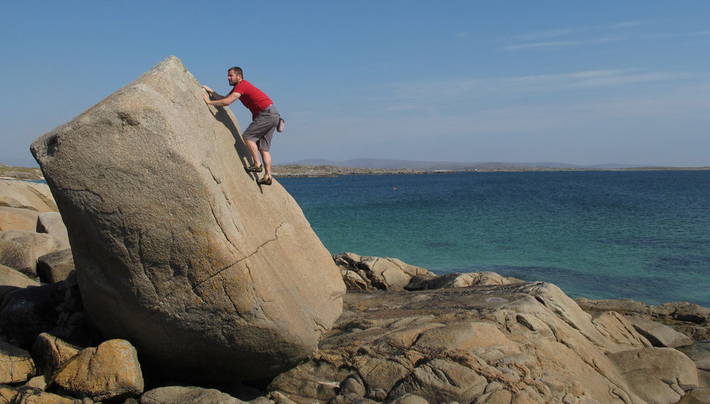 Easy angled slabs with plenty of big holds are the ideal boulder problems for beginners. Diarmuid Smyth in Roundstone, Galway, , 123 kb