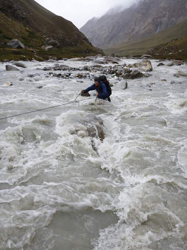 HarryB struggles to cross the fast flowing Djangart river on the return to basecamp - Photo by George Cave, 131 kb