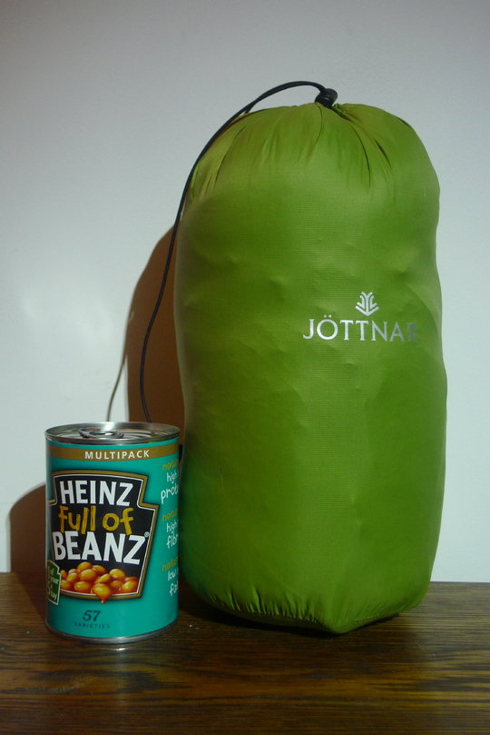 The Jottnar Fjorm Down Jacket next to a tin of beans for size comparison, 57 kb