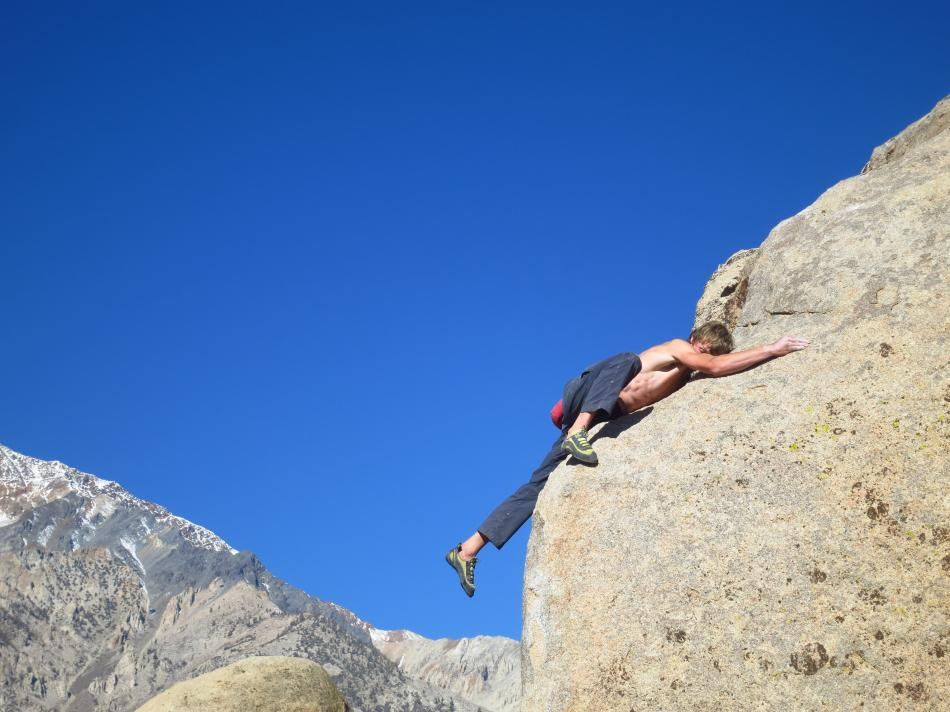 Howard Lawledge bellyflopping on the top-out of Pope's Prow, V6, Buttermilks, California, 80 kb