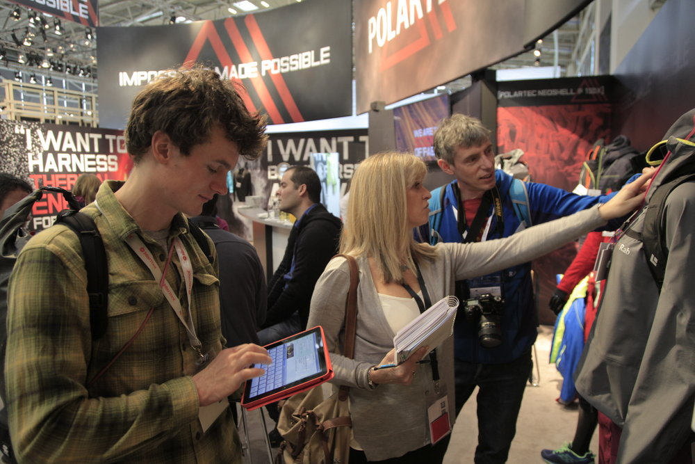 Rob Greenwood and Alan James get shown new garments at ISPO 2014, 152 kb