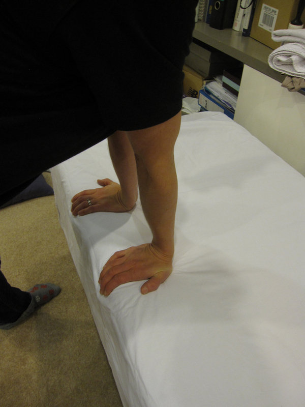 a) Wrist flexor with fingertips off table, 67 kb