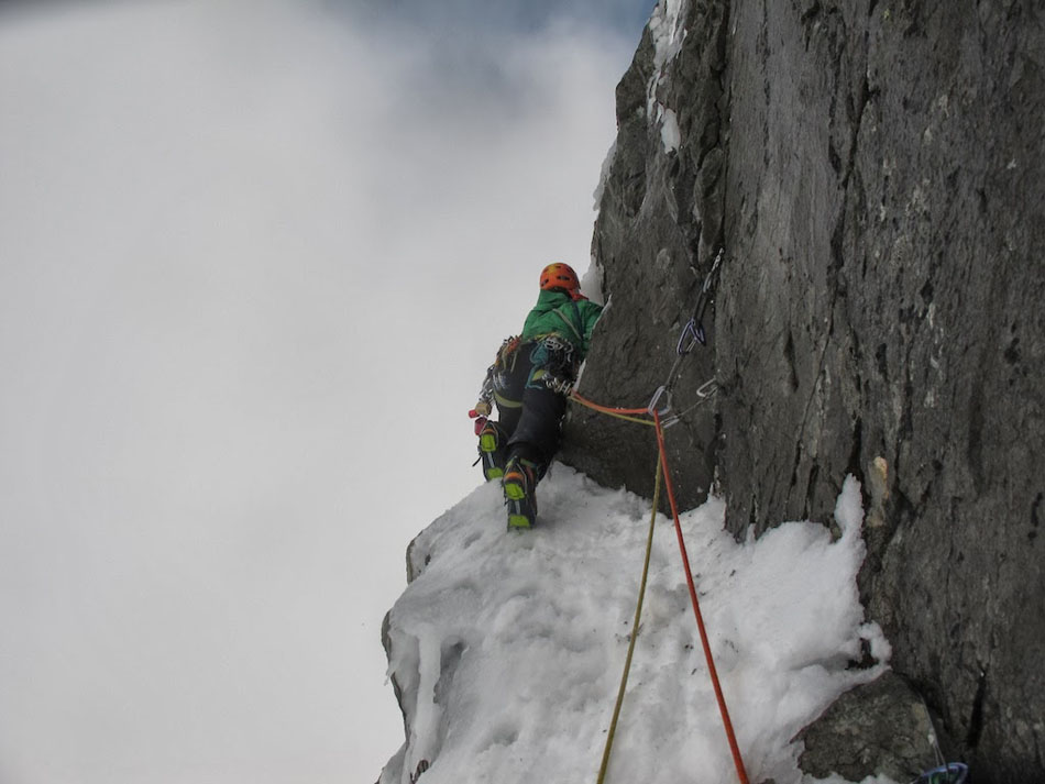 Adam Hughes climbing poorly protected ice on pitch 2 of Orient Express, Ben Nevis, 95 kb