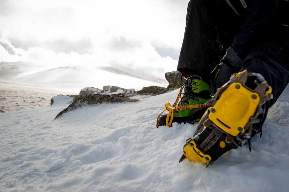 My friend putting crampons on for the first time. , 131 kb