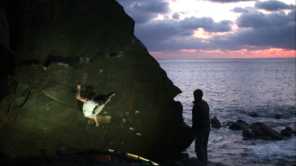 Tom in the middle of the crux of Wonderland, 8A, Priest's Cove, Cornwall, 95 kb
