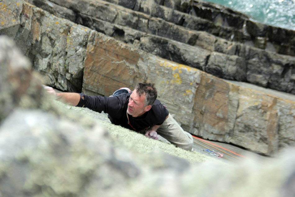 Dave Birkett on the final moves of Daddy Cool, E8 6b, Carreg-y-Barcud, 149 kb