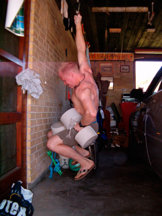 Peter Mortensen hanging from his middle finger with an extra 32kg of weight., 137 kb