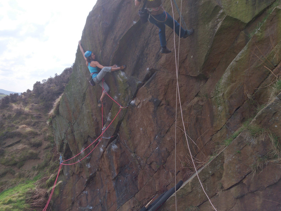 Naomi Buys making the FA of Overlooked, E7 6b, Newchurch Quarry, 155 kb