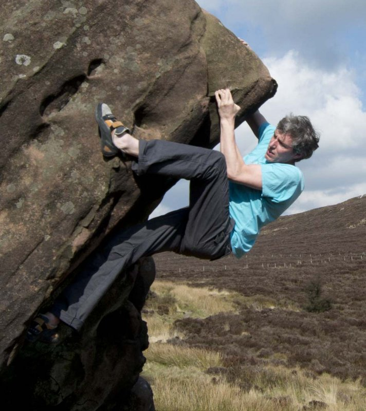 Alan James climbing Crack and Arete (V3) at the Newstones. Photo: Duncan Campbell, 100 kb