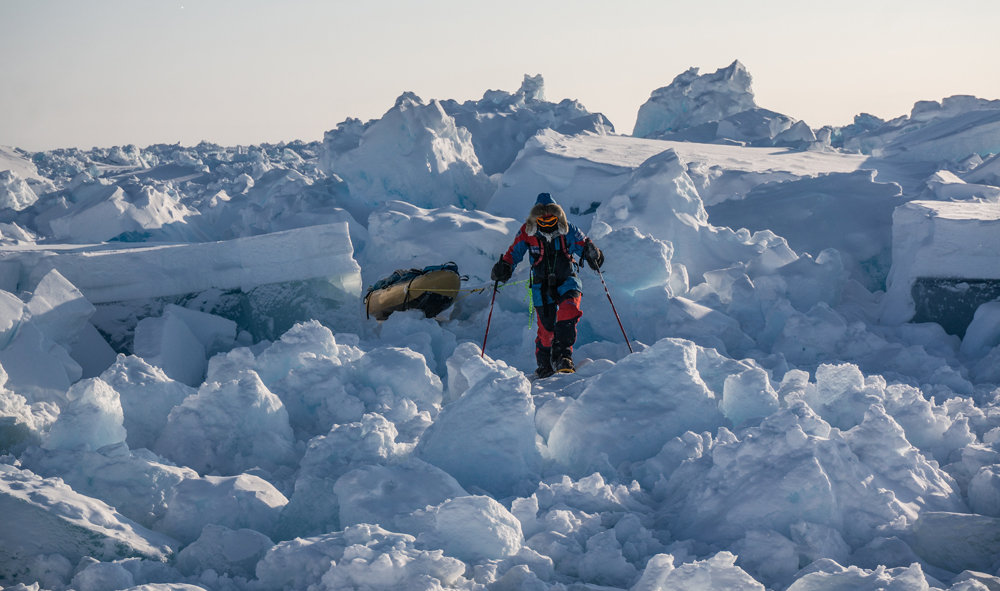 Ryan Waters snowshoeing through pressure ice on the expedition, using MSR snowshoes and MSR poles , 140 kb
