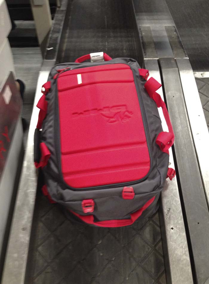 DMM Void Duffle - Disappearing down the normal conveyor at Manchester, 56 kb