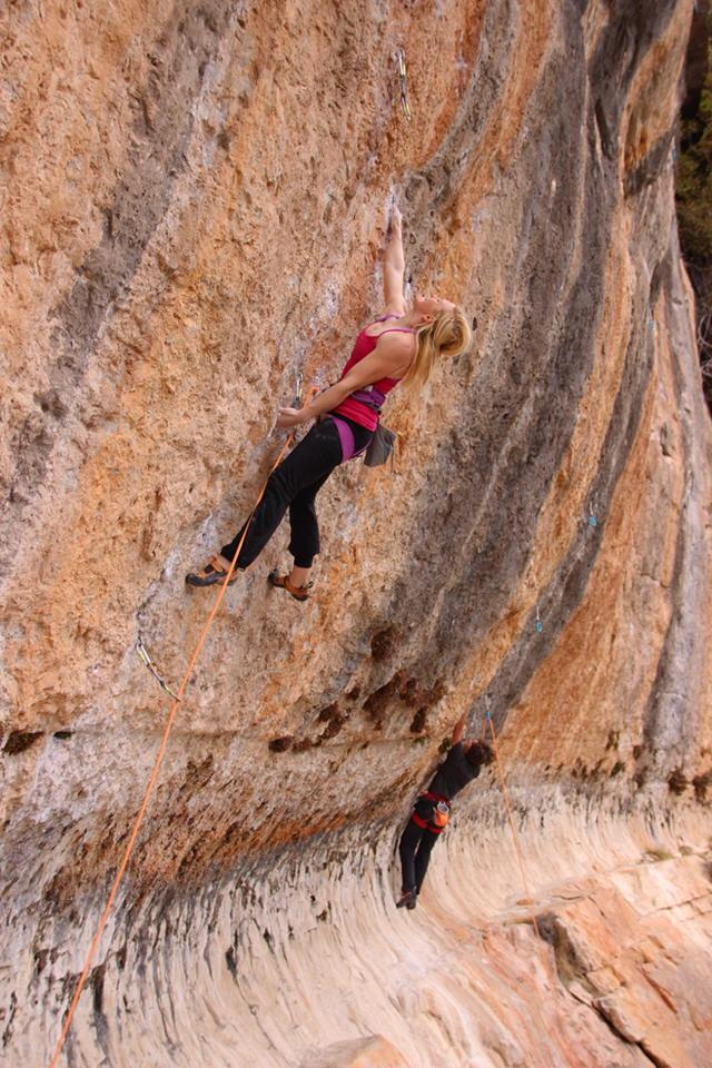 Leah Crane at full stretch on Anabolica, 8a, Siurana, 125 kb