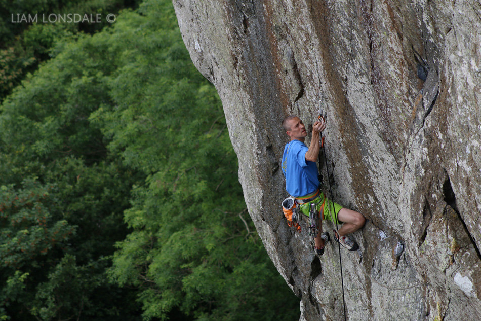 Steve McClure sorting the fiddly lower runners on his re-enactment of his onsight of Strawberries, E7 6b, Tremadog, 215 kb
