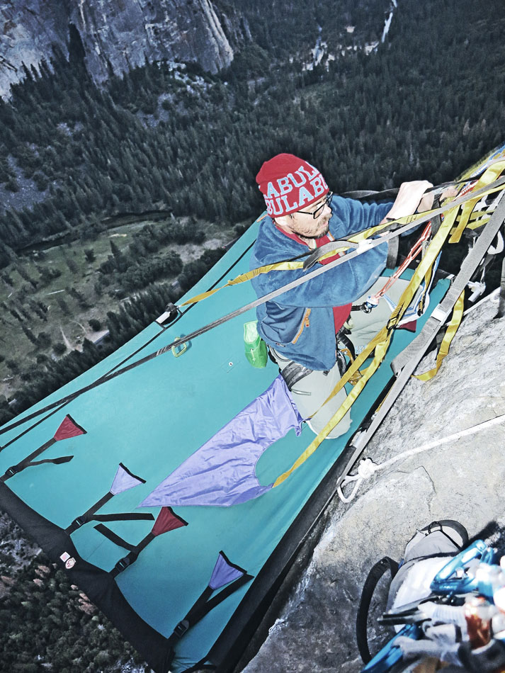 Although a portaledge isn't totally necessary, it can be an advantage. Here Andy sets his up whilst it is still daylight., 216 kb