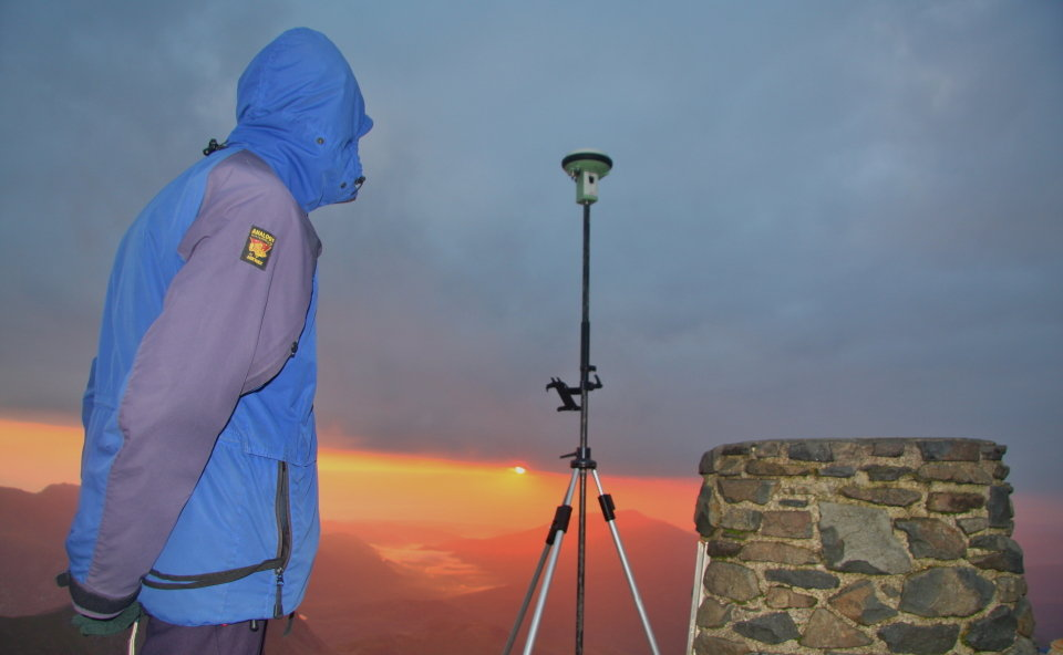 Graham watching the sunrise over Moel Siabod from the summit of Snowdon, 73 kb