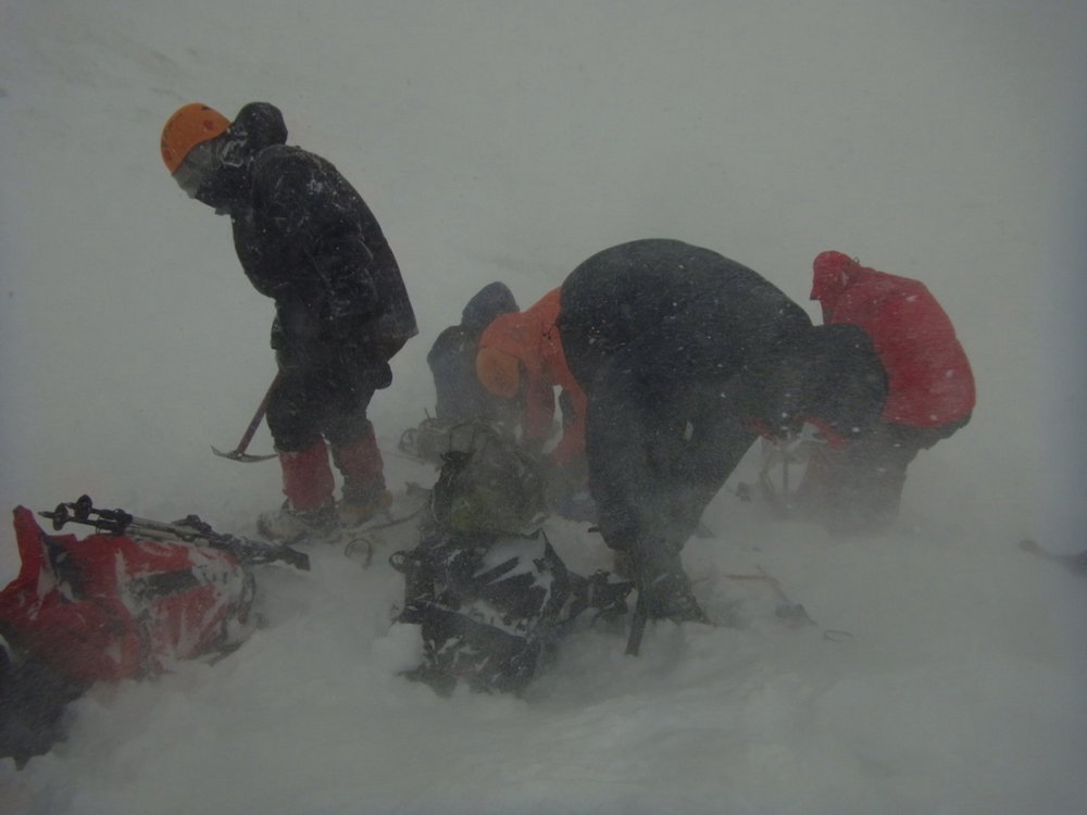 Putting crampons on in a blizzard, gloves a must!, 61 kb