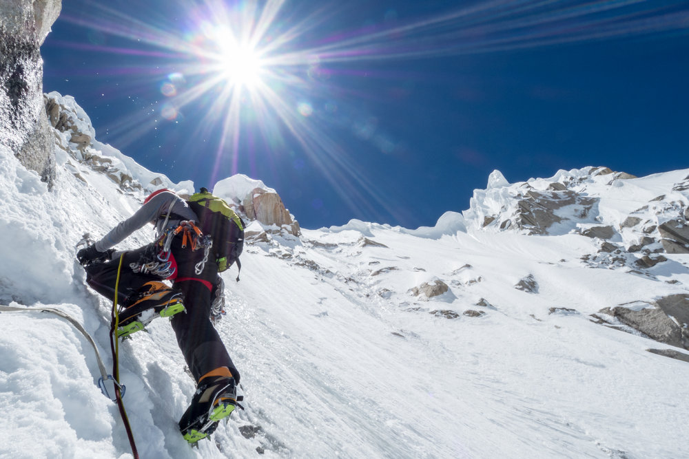 Andy climbing the upper slopes of the NW Face under the powerful Karakorum Sun., 159 kb