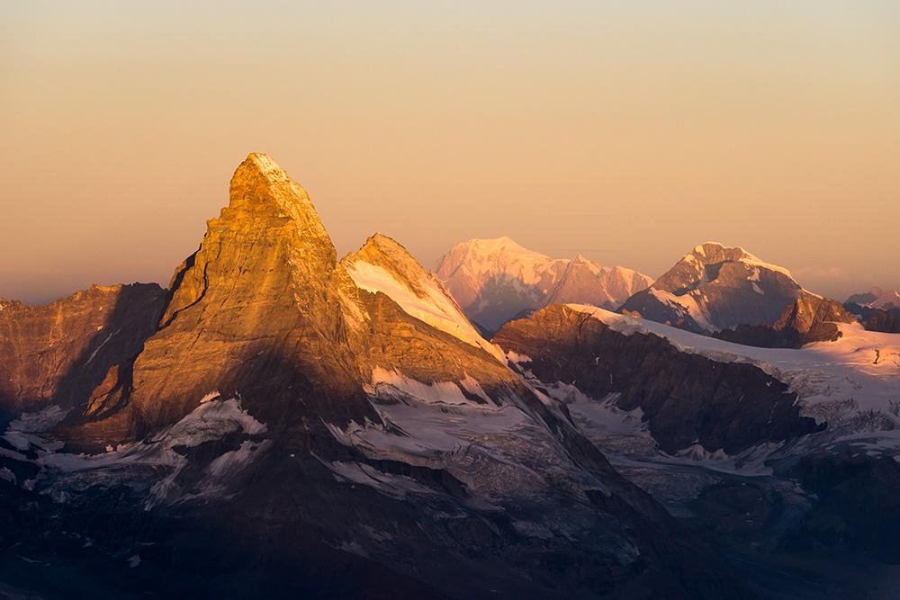 Matterhorn, Mont Blanc and Grand Combin at sunrise from the Rimpfischhorn, 195 kb