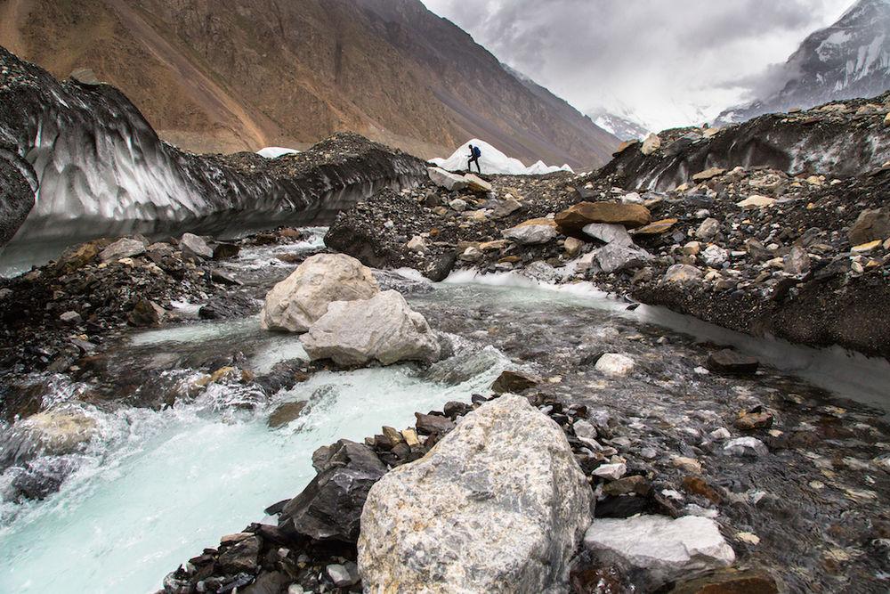 Sergiu Jiduc crossing one of the many supraglacial streams on Yukshin glacier, 207 kb
