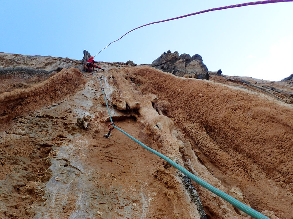 Jacob leading the tufa- drenched crux pitch of Taghazout 8a 300m., 219 kb