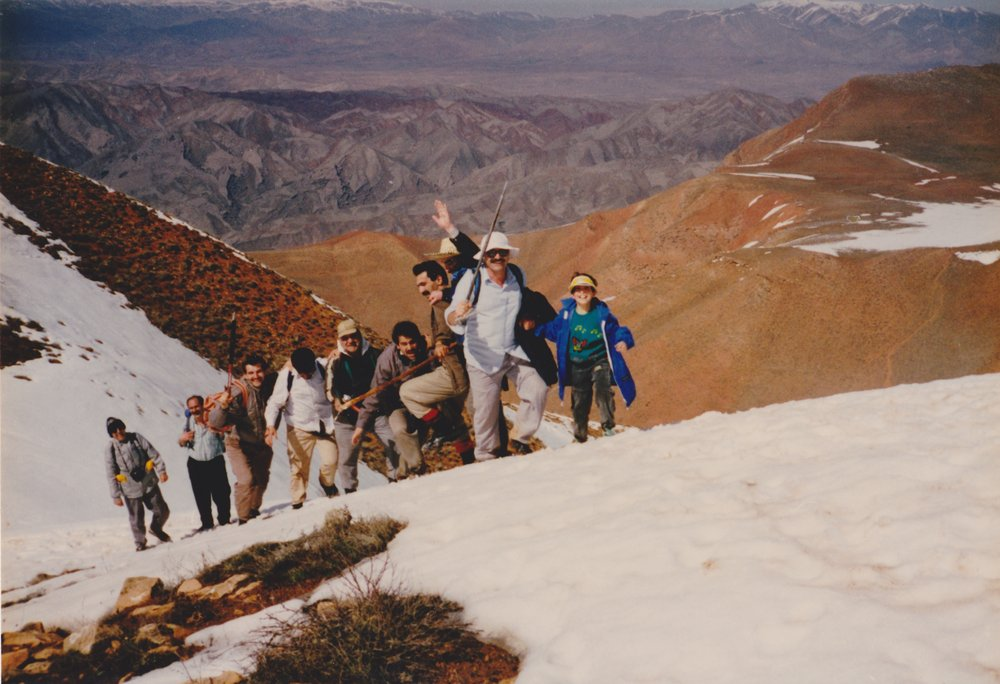 Shirin climbing with her father and his male friends as a young girl, 115 kb