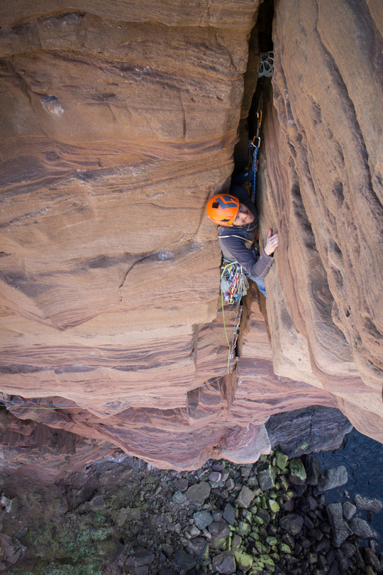 Witold from Poland enjoying every moment of the sandy, offwidth crux of the Old Man of Hoy, 141 kb