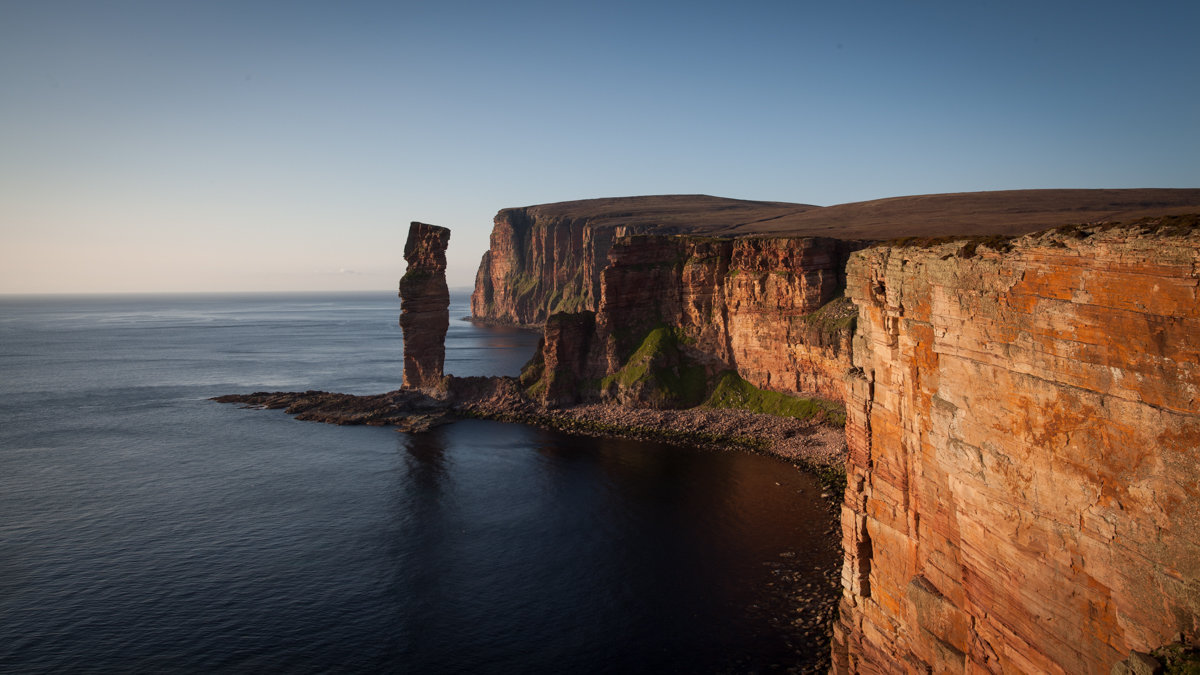 The Old Man of Hoy and St. Johns Head in the evening sun © Rob Greenwood - UKClimbing