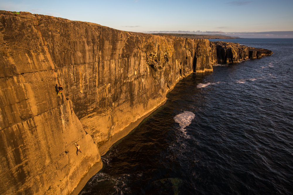 Colm Shannon making the first ascent of 'The Adventures of the Wonderwagon' Fr 7b+/7c S1/2 in beautiful evening light. , 234 kb