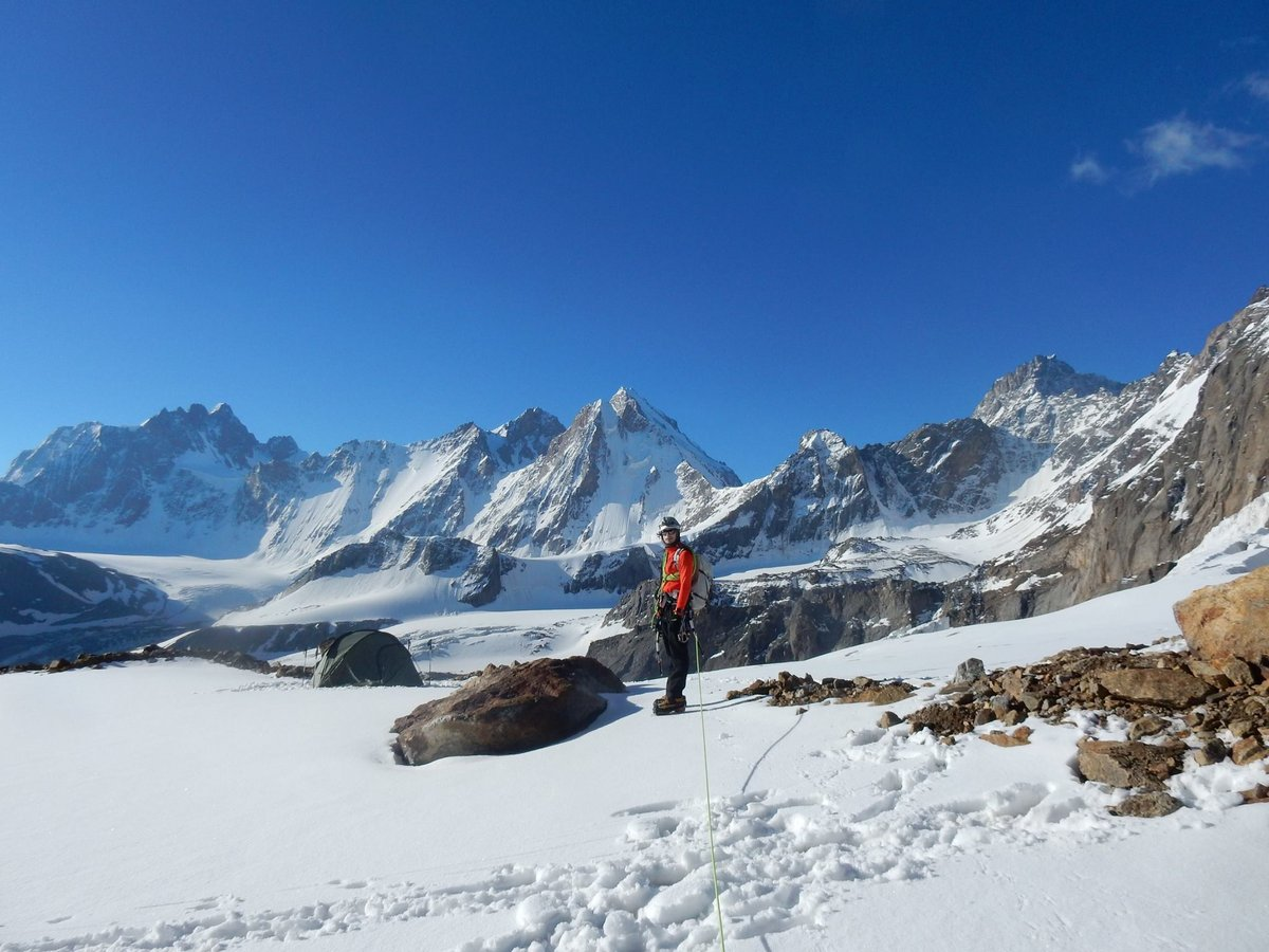Phil surrounded by unclimbed peaks, 160 kb