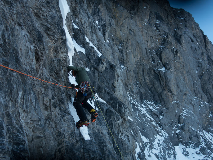 Thomas Huber climbs the first steep wall after the second ice field, 193 kb