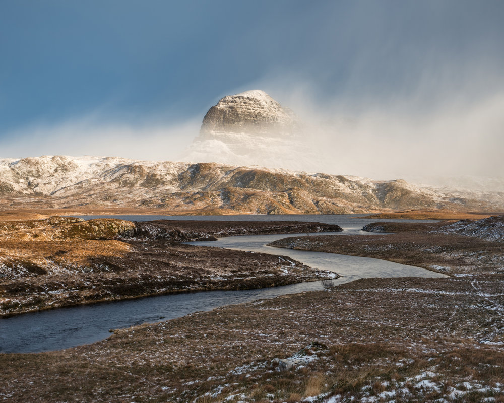 Suilven emerges from a winter storm, 215 kb