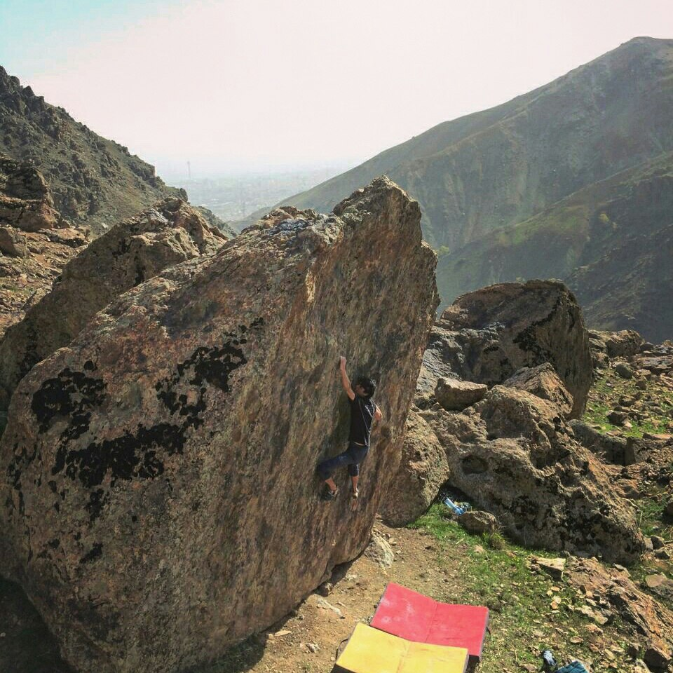 Aref Omidfar on Sun 7B at Band-e Yakhchal, Milad Tower just visible in the distance © UKC Articles