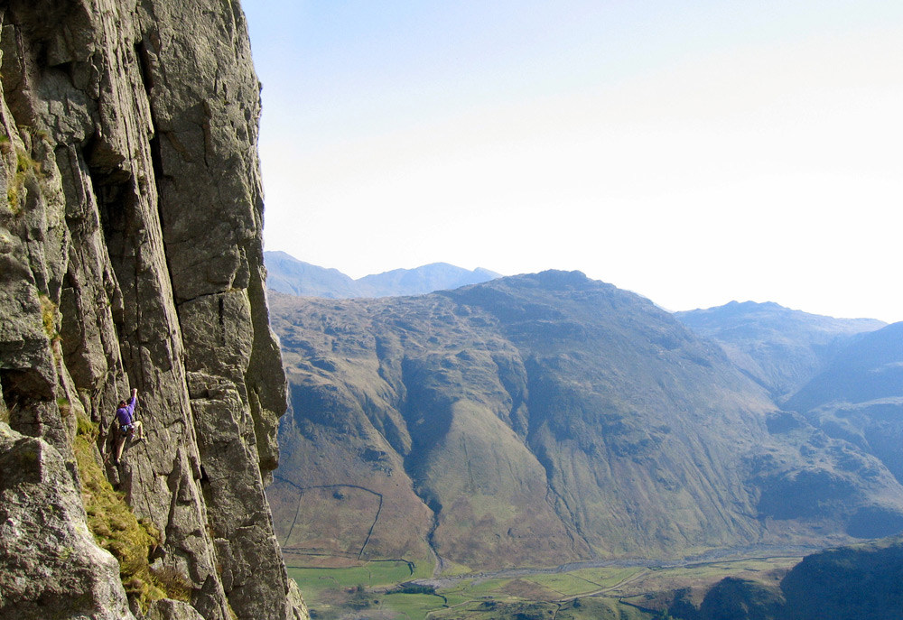 Climber on Inertia (HVS 5a), Gimmer Crag, Lake District. The big corner is The Crack (VS 4c), 230 kb