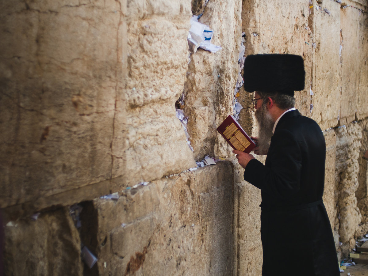 A Jewish man praying in front of the Western Wall in Jerusalem © UKC Articles