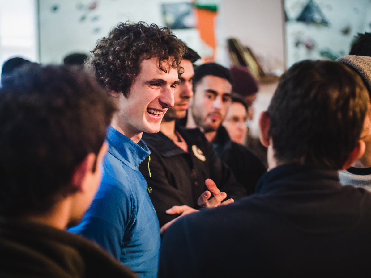 Adam chats to attendees at a slideshow in Haifa. © UKC Articles