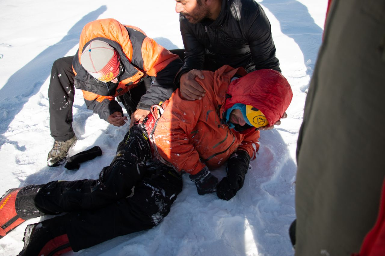 Alex Gukov is detached from the helicopter sling at Base Camp. © UKC News