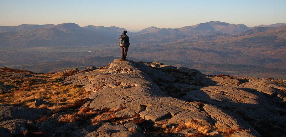 Aled Williams on top of Foel Penolau with Snowdon in the background © UKC News