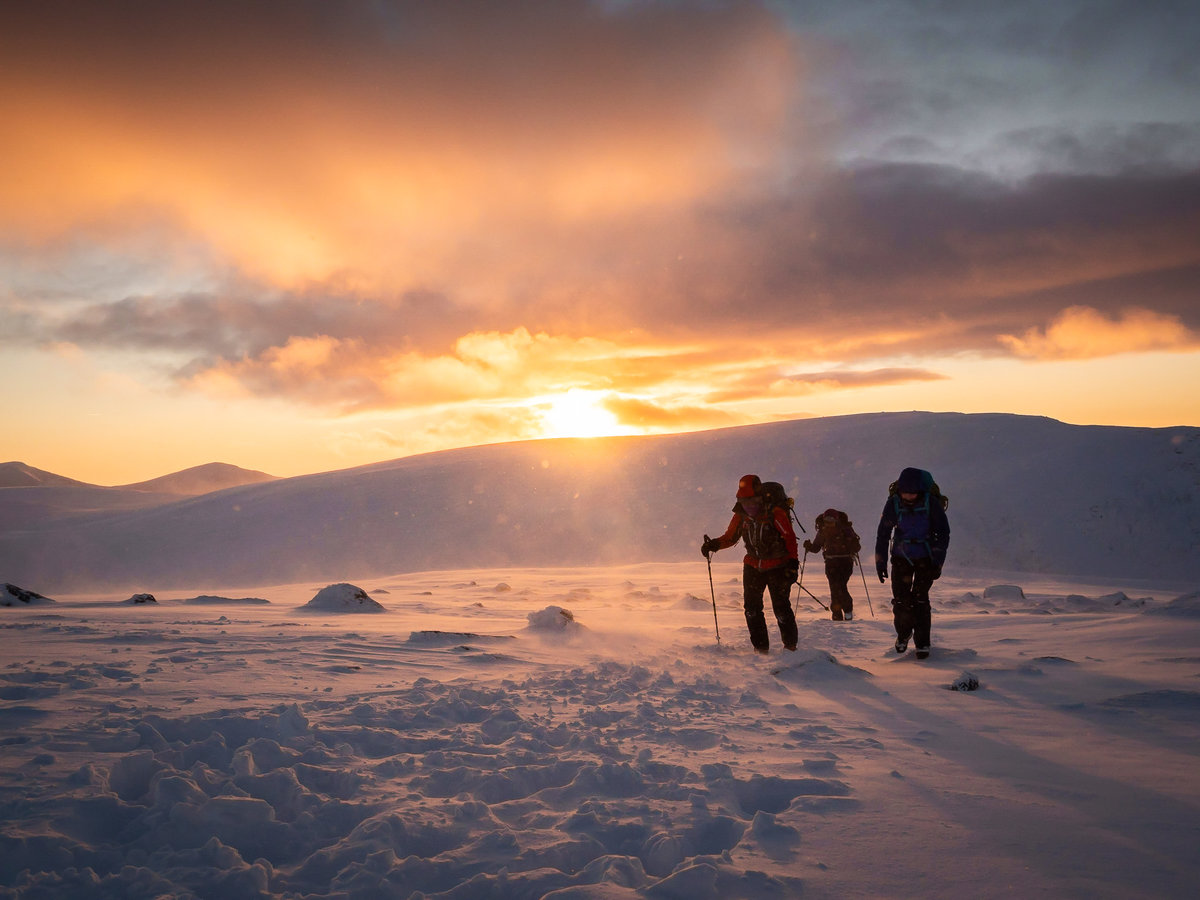 Mountaineers begin to descend at sunset above Corrie an t-Sneachda in Cairngorms National Park, Scotland. © Alexander_Metcalfe