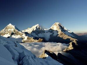 [First rays of sun hit Chopicalqui and Huscaran. Cordillera Blanca, Peru. © THE.WALRUS]