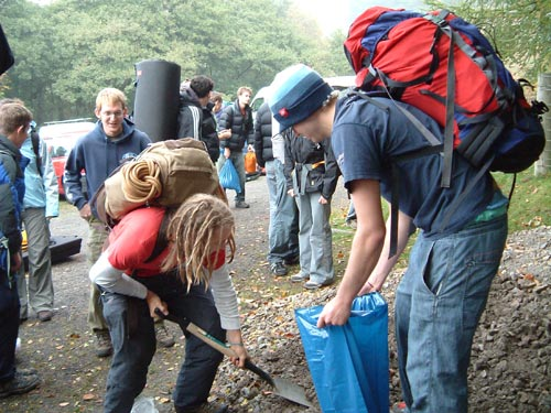 Newcastle Uni students move stone at Stanage, 59 kb