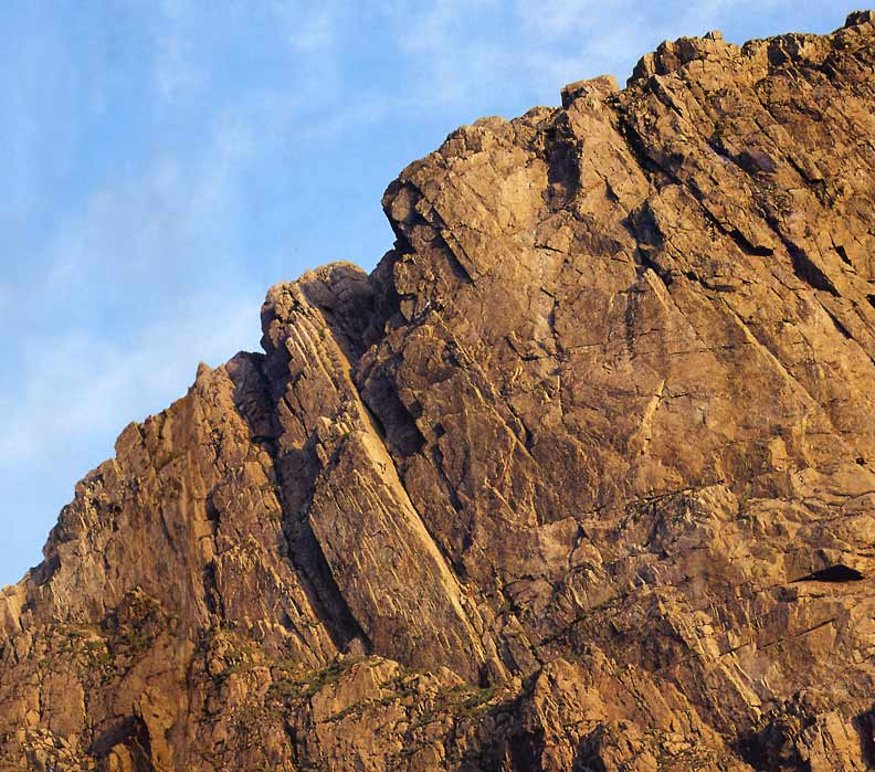 The mighty Scafell Crag on a midsummer evening. Climbers can be seen on Botterill's Slab., 103 kb