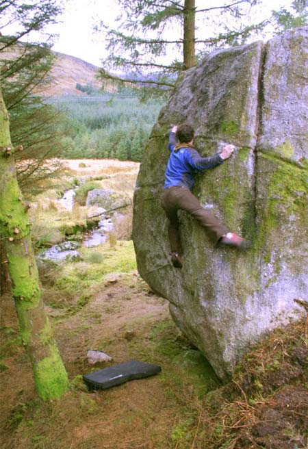 Ped McMahon on the Annalecka boulder that was recently found by Seamus Crowley., 63 kb
