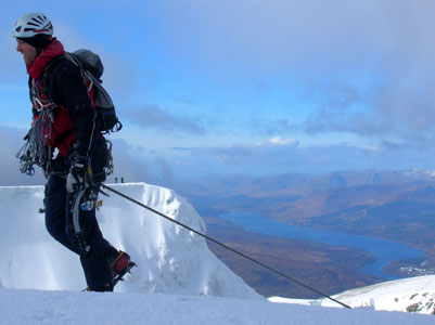 Pete Rowlands tops out from a thin Ben Nevis ice route with a large and mixed rack. , 21 kb