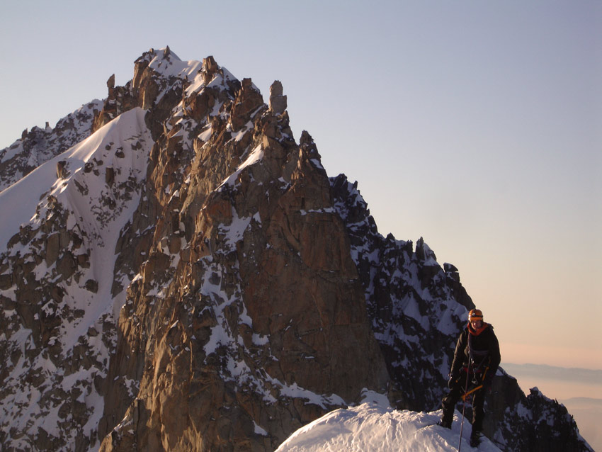 Jack Geldard - wearing a belay jacket on the summit of Les Courtes in winter., 114 kb