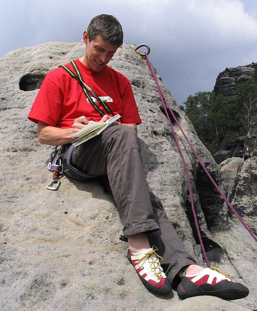 Signing a summit book on Hintere Reibung (VIIa), Schrammsteinkegel, Elbesandstein, Germany., 98 kb