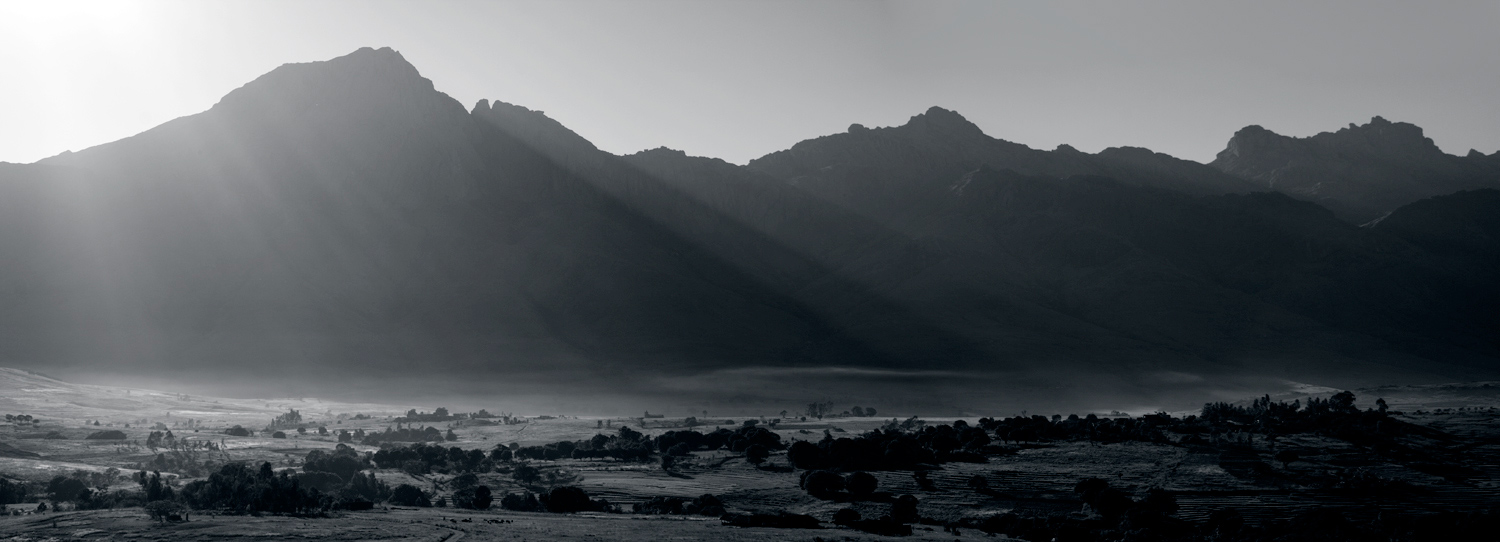 Early morning sun burns mist from rice fields in the Tsaranoro valley, Madagascar, 255 kb
