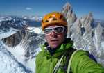Colin Haley: Self portrait on the summit, with Fitz Roy and Poincenot behind., 4 kb