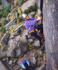 Joe Brown repeating The Right Unconquerable, Stanage, 47 years after making the first ascent, belayed by Claude Davies